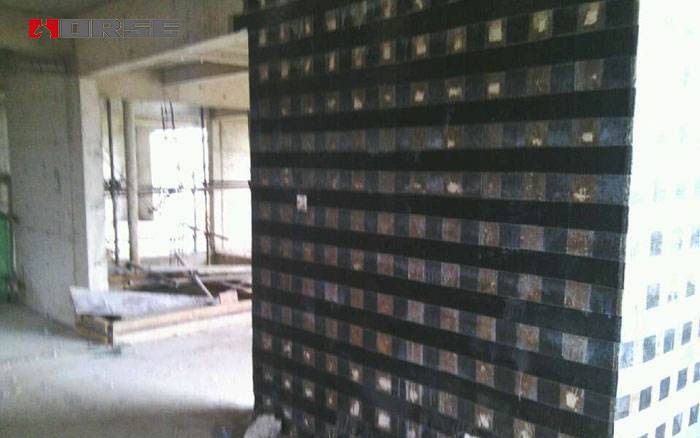 Reinforcement of concrete shear wall with fiber reinforced