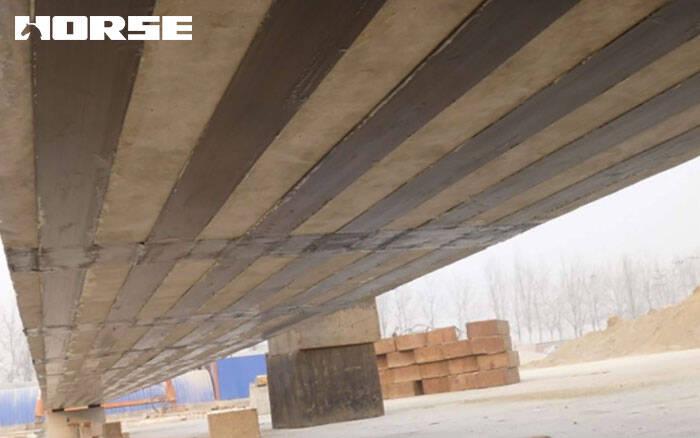 Strengthening beam bridgewith carbon fiber plates