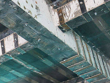 Strengthening concrete beams with steel plates